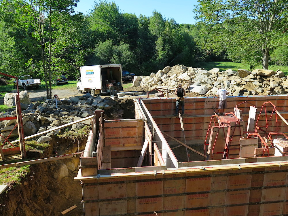 August 27, 2014 - Foundation going up & a big pile of granite